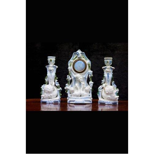 Antique ceramic clock with 2 candlesticks