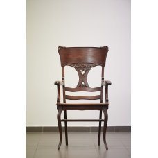 Antique mahogany chair with rattan