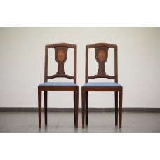 A pair of antique mahogany chairs with walnut inlay