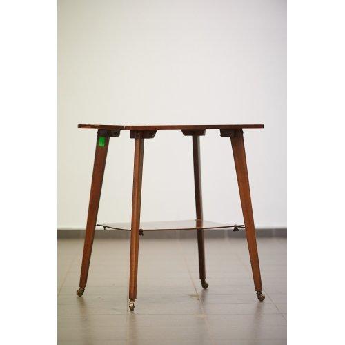 Antique mahogany table on wheels