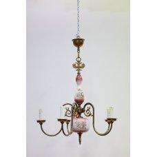 Antique metal chandelier with ceramic elements