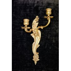 Antique wall candle sconce made of gilded bronze