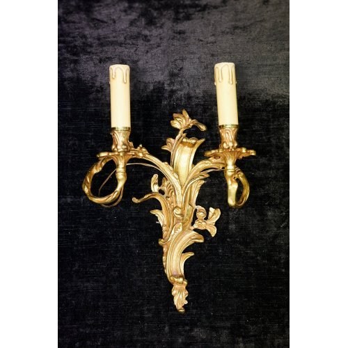 Rococo style wall light of gilded metal