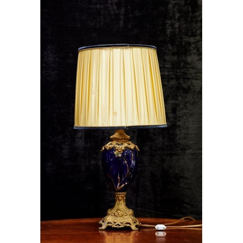 Vintage style table lamp with blue glass and bronze finish