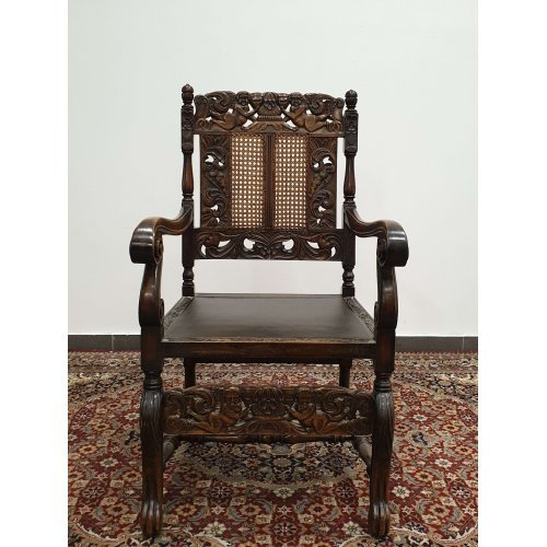 Antique chair of mahogany with armrests