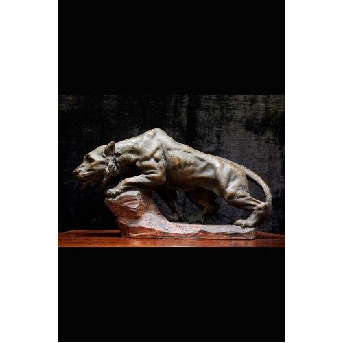 Antique carved lion sculpture by R. Autilic